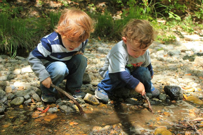 Boys with sticks in Reservoir Canyon Creek
